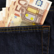 Euros in back pocket — Stock Photo