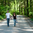 Young couple in forest — Stock Photo #3556548