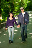 Young walks couple in forest — Stock Photo