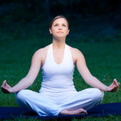 Cute girl meditates in nature — Stock Photo