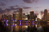 Miami Skyline at night reflecting in water — Stock Photo