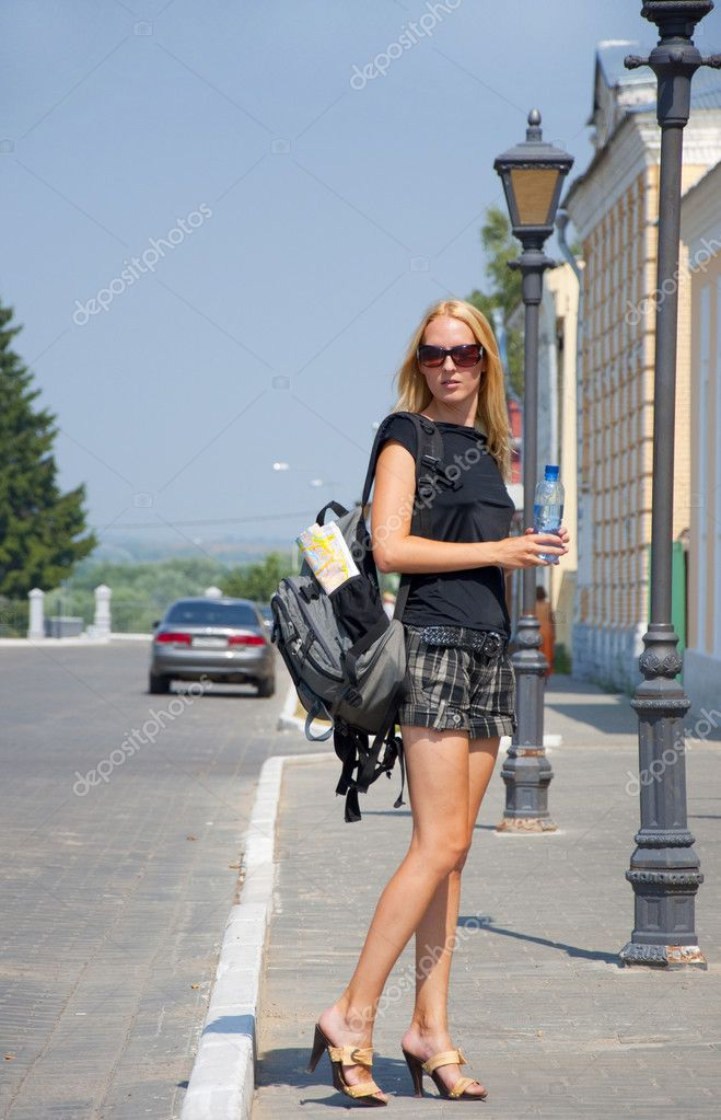 The girl-traveller with a backpack in the street — Stock Photo #3578527