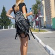 The girl-traveller with a backpack in the street — Stock Photo #3630800