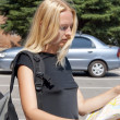 Стоковое фото: The girl-traveller with a map of the city