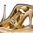 Sexual gold shoes on a high heel — Stock Photo