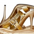 Sexual gold shoes on a high heel - Stock Photo