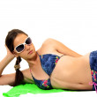 Pretty girl is on beach in a bathing suit — Stock Photo