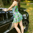 Stock Photo: The sexual girl in standing near the sport car