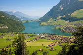 View to a town on a lake in mountains — Stock Photo