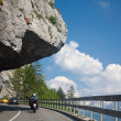 Road in mountains which goes under the rock — Stock Photo