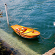 Orange boat on water — Stock Photo