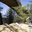 Tourist walking by the natural bridge - Stock Photo