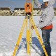Stock Photo: Measuring height of theodolite
