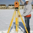 Measuring height of theodolite — Stock Photo