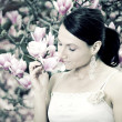 Girl and Magnolia flowers — Stock Photo