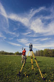 Land Surveyor working with robotic station — Stock Photo