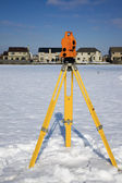 Theodolite in snow — Stock Photo