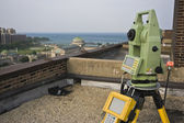 Theodolite on the rooftop — Stock Photo