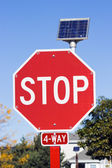 STOP sign powered by a solar battery — Stock Photo