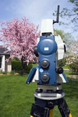 Theodolite and spring colors — Stock Photo