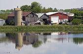 Old farm reflected — Stock Photo