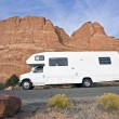 Stock Photo: RV in front of red rocks