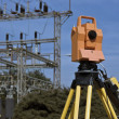 Stock Photo: Surveying under electric wires