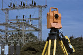 Surveying under electric wires — Stock Photo