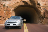 Silver SUV driving in Utah. — Foto Stock
