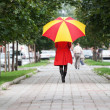 Stock Photo: Woman walking with an umbrella
