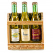 Six souvenir bottles in wooden box — Stock Photo