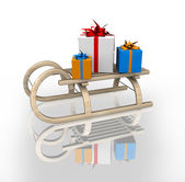 Gift box in sled — Stock Photo