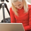 Female Photographer with a laptop — Stock Photo