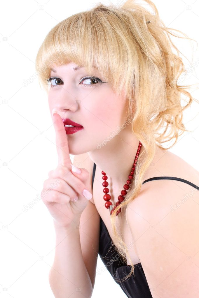 Young girl with her finger over her mouth  Stock Photo #3599144