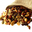 Trail mix of nuts, seeds, and dried fruit. - Stock Photo