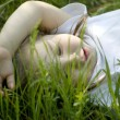 Nice small girl lays on green grass — Stock Photo #3673828