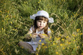 Little girl holding flowers — Stock Photo