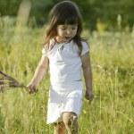 Little girl holding flowers — Stock Photo #3692721