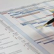 Gantt Chart with hand holding pen - Stock Photo