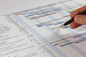 Gantt Chart with hand holding pen — Stock Photo