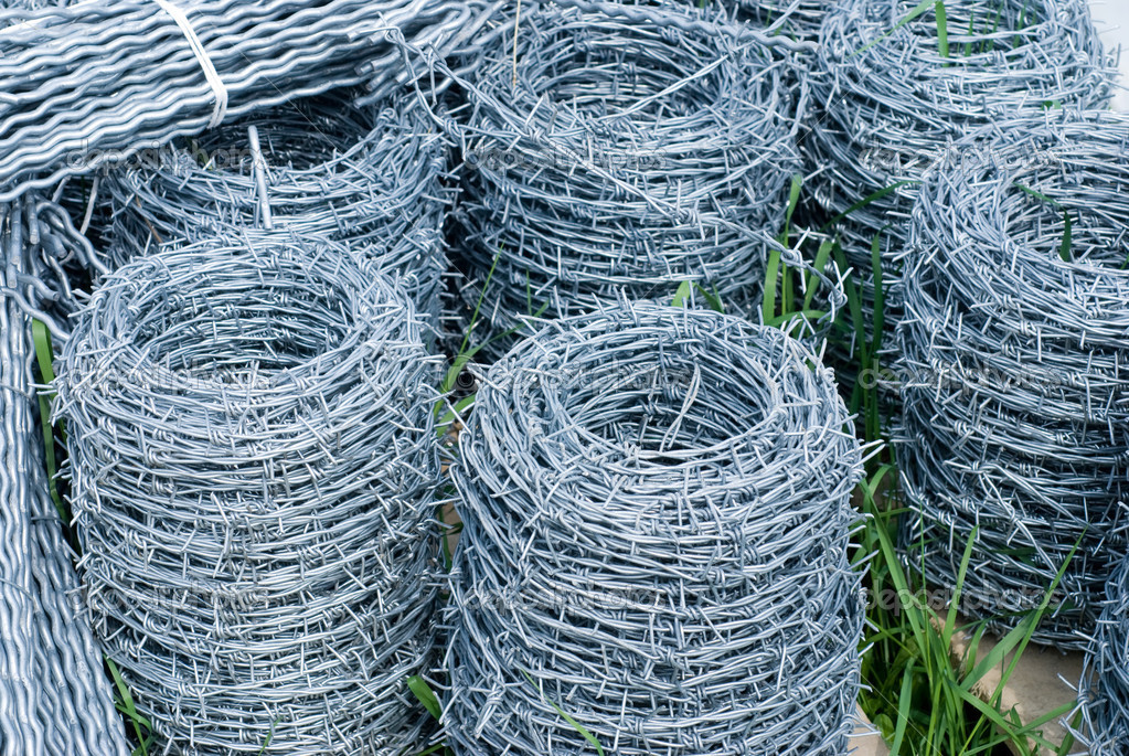 Rolled barbed wire in coils  Stock Photo #3649101