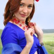 Gipsy girl in blue - Stock Photo