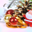 Santa near the Christmas tree and balls - Stock Photo