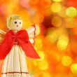 Straw angel on the background lights defocus — Foto de Stock