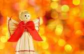 Straw angel on the background lights defocus — Stock Photo