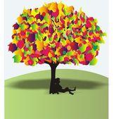 The boy under a wonderful colour tree — Stock Vector