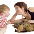 Stock Photo: Mother and son with cat and kitten