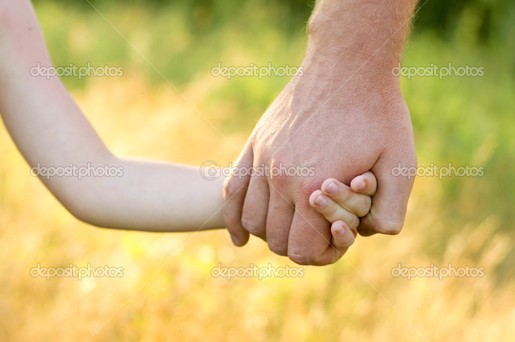 Father lead by the hand son outdoor — Stock Photo #3666244