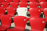 Red Tribune Seats in a stadium - detail view — Stock Photo
