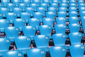 Blue Tribune Seats in a stadium - side view — Stock Photo